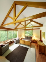 <h5>4. The finished cabin</h5><p>Two feature King-Post Trusses set-off beautifully by the white ceiling</p>