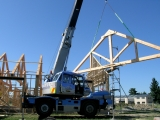 <h5>3. A crane is used to lift the trusses into place.</h5>