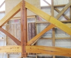 <h5>1 King Post truss with curved tie-beam, this external truss was crafted from cedar</h5>
