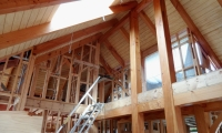 <h5>1 Feature post and beam frame nearing completion</h5>